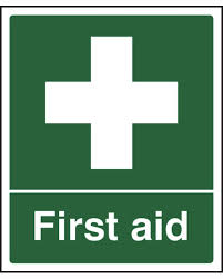 First Aid sign on green background