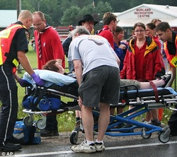 injured person being treated on a stretcher